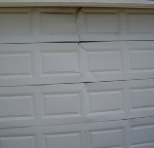 cracked-garage-door-panels-Raleigh